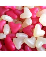 Pink and white jelly bean sweets in the shape of love hearts