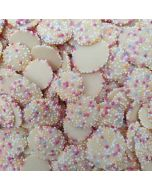 Retro white chocolate flavour buttons with multicoloured sprinkles on top