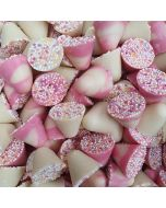 Strawberry and cream flavour chocolate candy in a spinning top shape with sprinkles on top