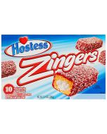 A full box of American Hostess Cakes dipped in jam sprinkled with dessicated coconut