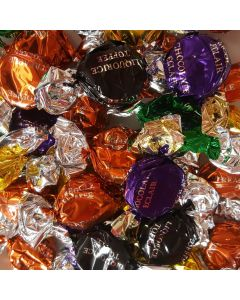 An assortment of different flavoured individually wrapped toffees