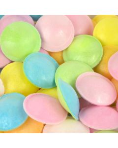 Multicoloured edible paper discs filled with sour sherbet powder
